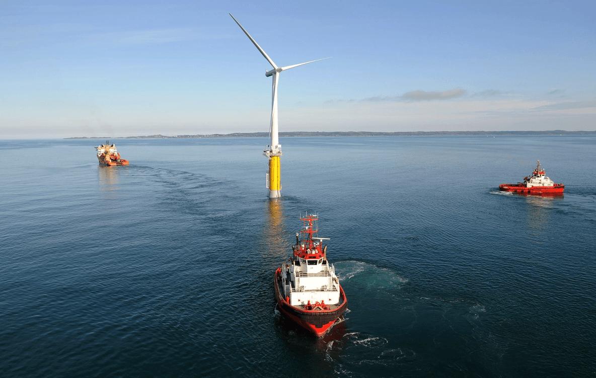 Three vessels transporting a floating wind turbine