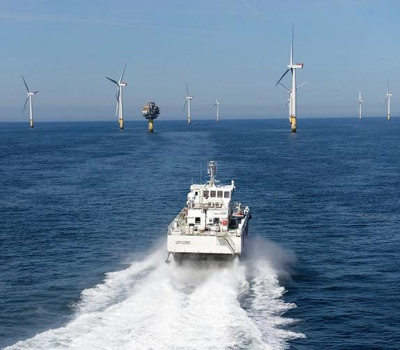 Photo of Umoe Mandal`s crew transfer vessel sailing towards an offshore wind farm