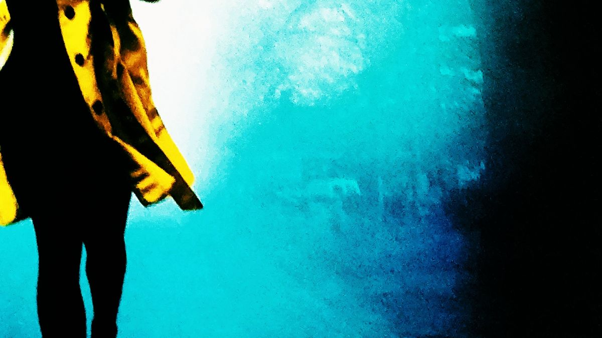 Cover detail of Find You First by Linwood Barclay showing a woman running wearing a yellow coat