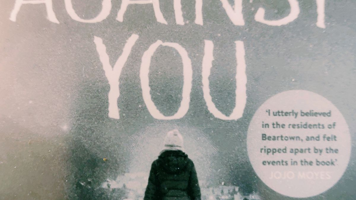 Cover detail of Us Against You by Fredrik Backman showing a woman walking in the snow