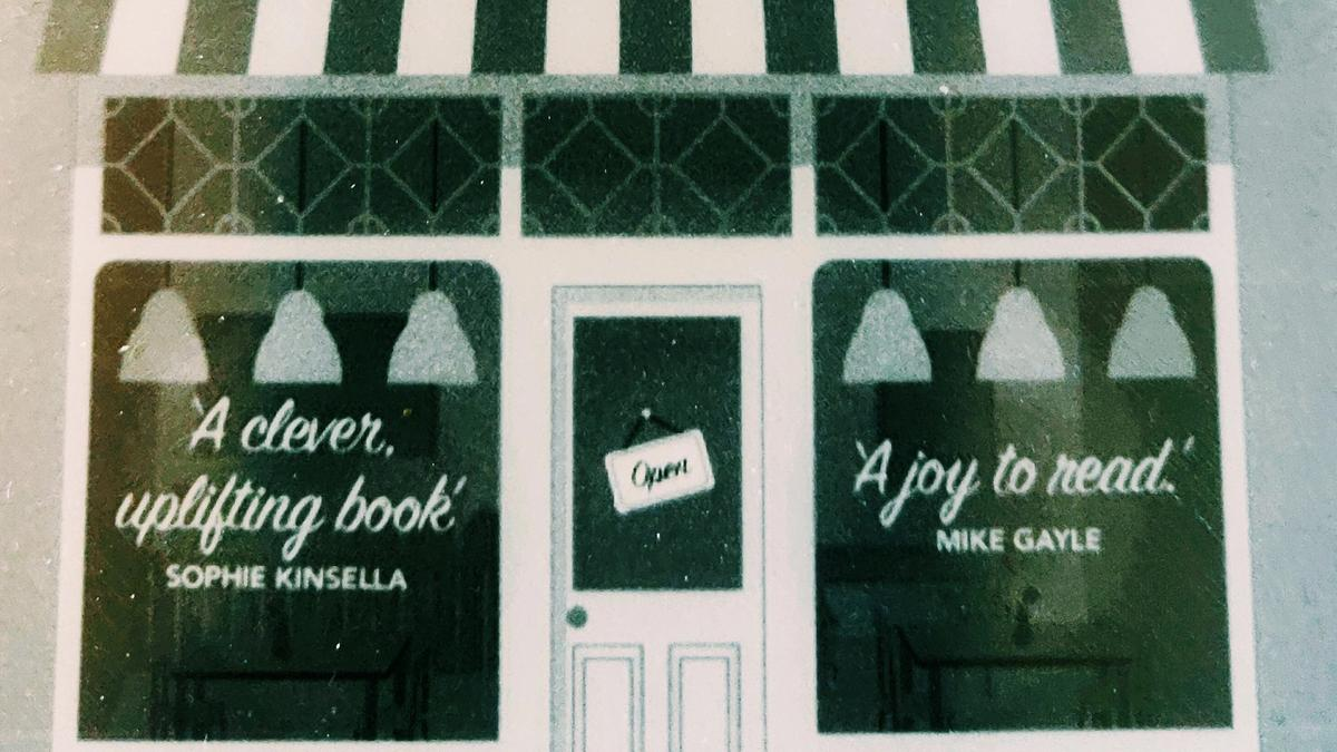 Cover detail of The Authenticity Project by Clare Pooley showing a cheerful shop window