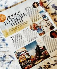 Books to escape with article showing an open magazine on a blue and white background