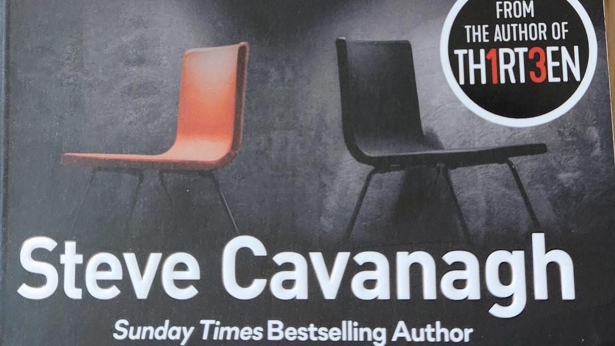 Cover detail of Fifty Fifty by Steve Cavanagh, showing an orange and black chair back to back