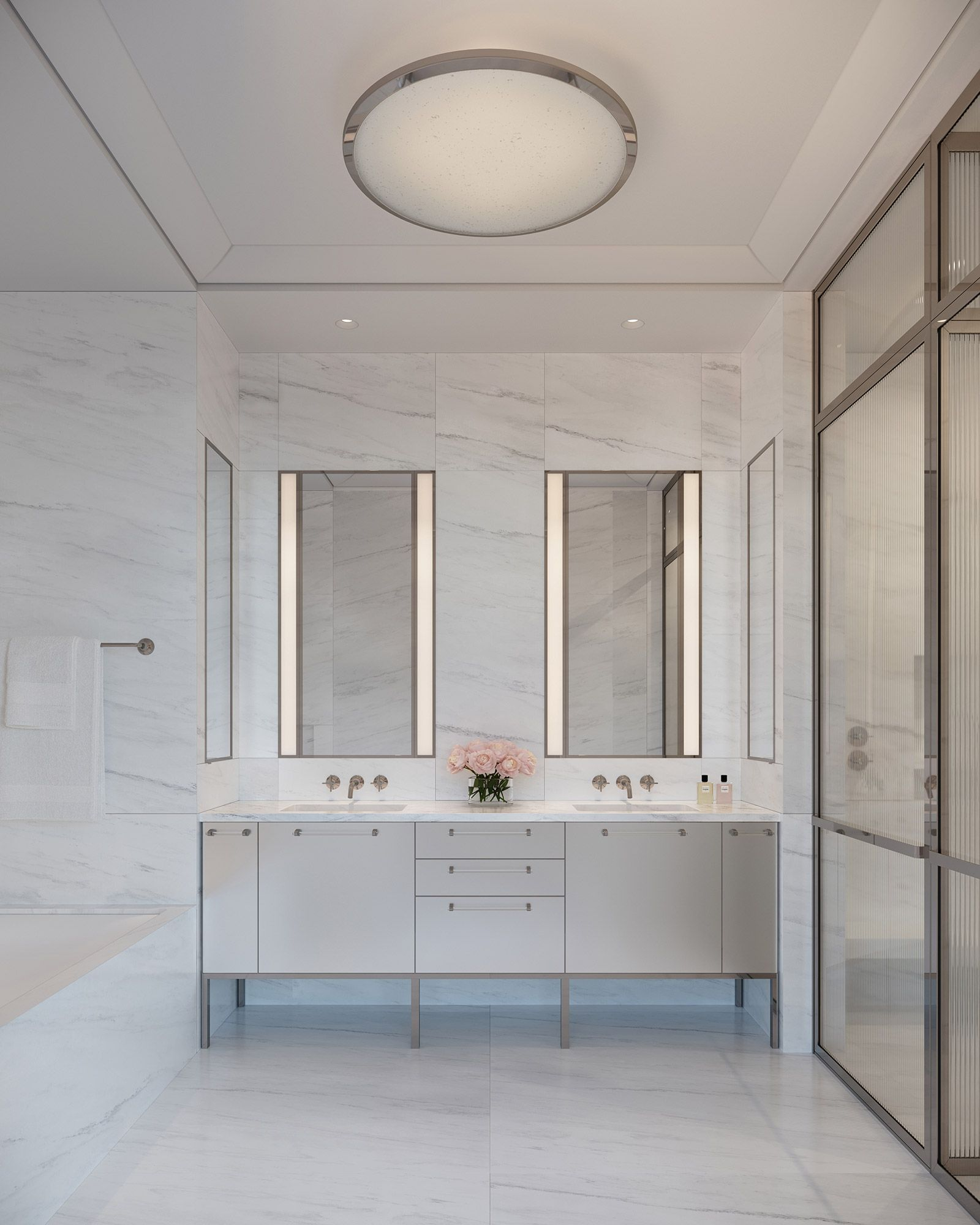 Primary bathroom featuring slabs of Olympic Danby marble