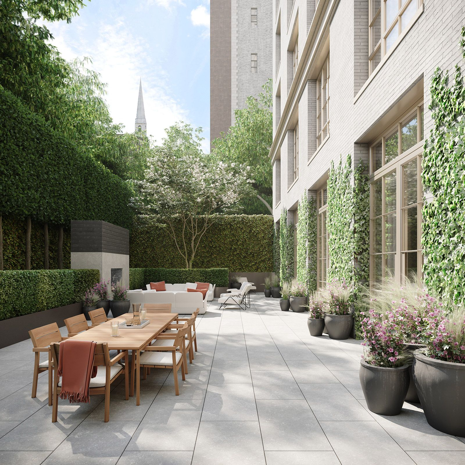The Townhouse private garden with outdoor fireplace