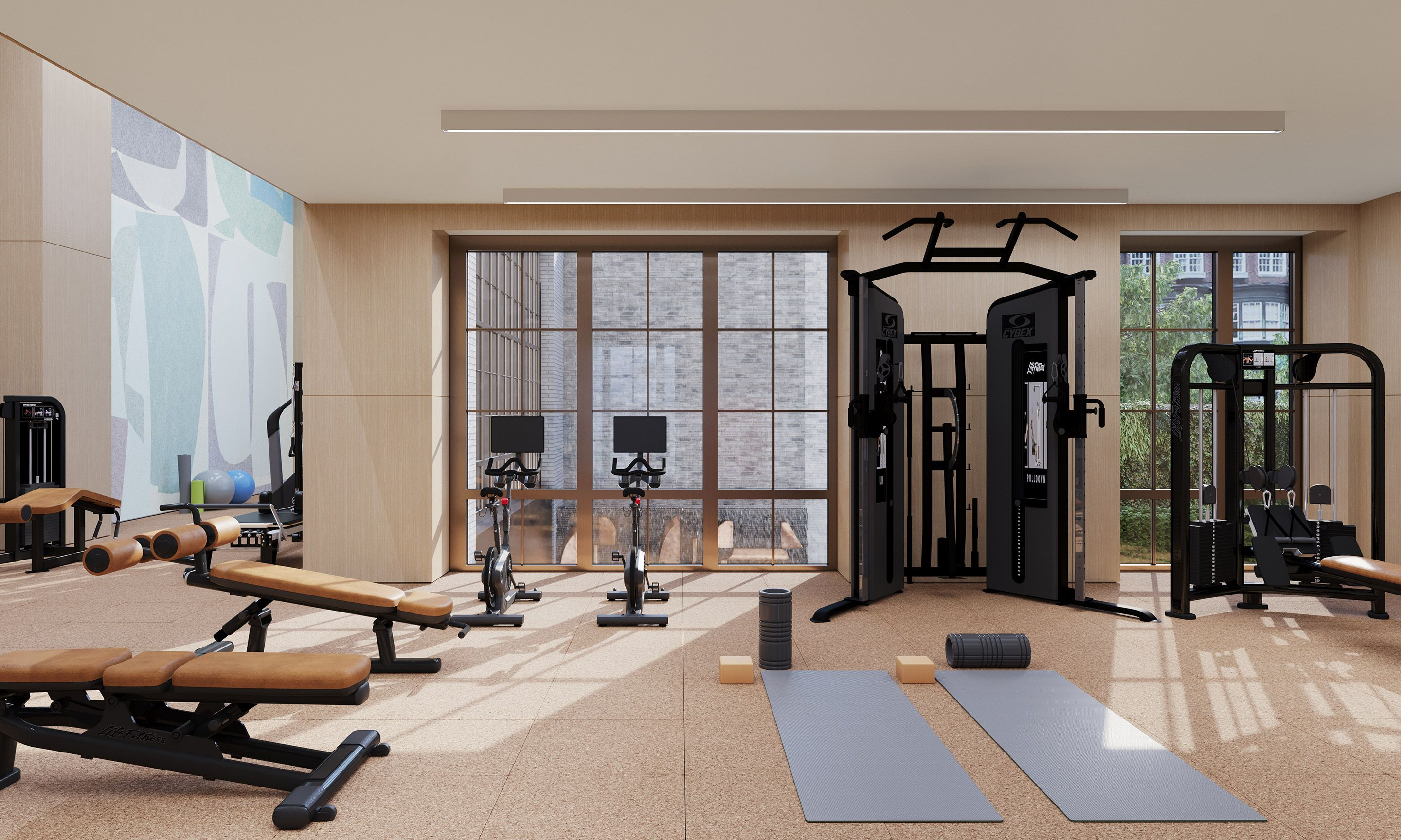 Double-height Fitness Center designed by The Wright Fit, with wall mural by Mig Perkins, overlooks the Garden and its sculptural water wall