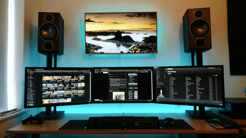 Epic Wall-Mounted Triple Monitor Desk Setup