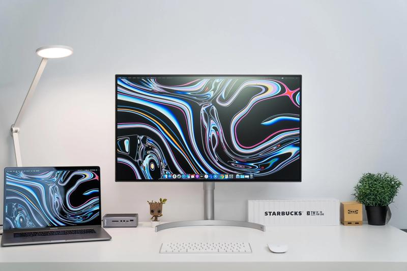 Clean white 32 inch monitor setup