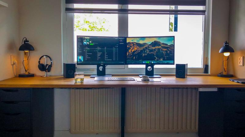 Dual monitor desk setup with under-desk mounted mac mini