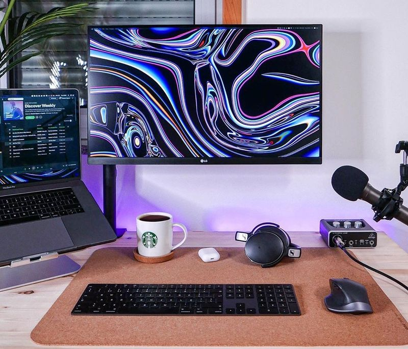 Designer's minimal setup with 27 inch monitor and Macbook Pro 15