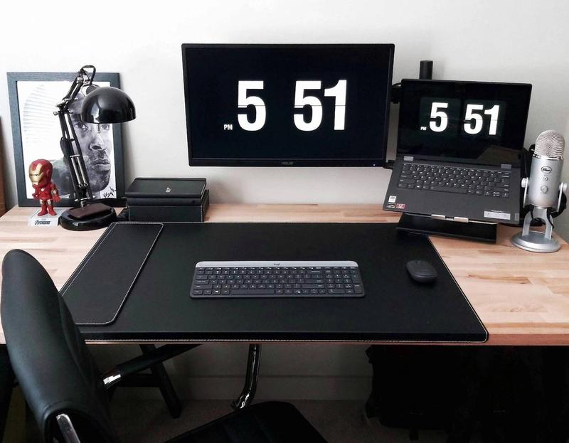 Clean black-themed desk setup