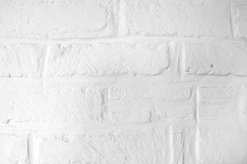 Creamy white brick wall