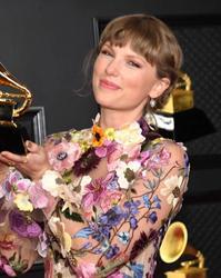 Taylor Swift wins big at Grammys 2021