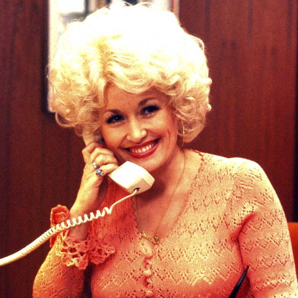 Dolly Parton staring in the film 9 to 5