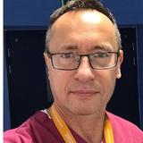 Dr Attila Aros