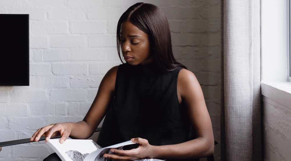 Dara Oke, head of West and South Africa at Alter Global, reads a magazine.