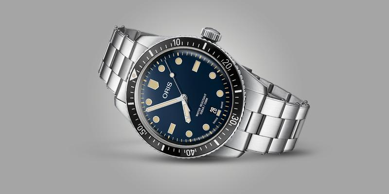 Oris Diver 65 with blue dial on bracelet laying on its side