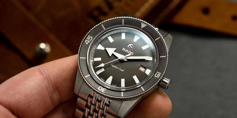 Rado Captain Cook 42mm Diver watch held in a hand black dial