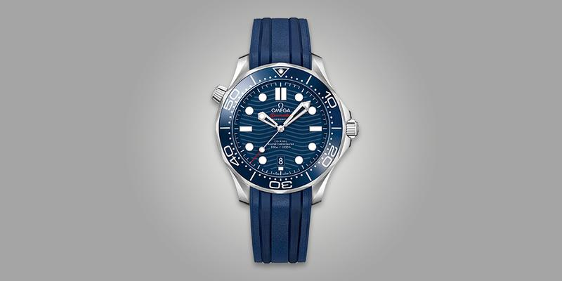 Omega Seamaster 300m diver's watch with blue dial and blue rubber strap.