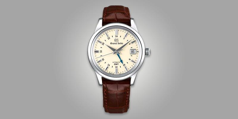 Grand Seiko SBGM221 GMT Dress watch with white dial on brown leather strap