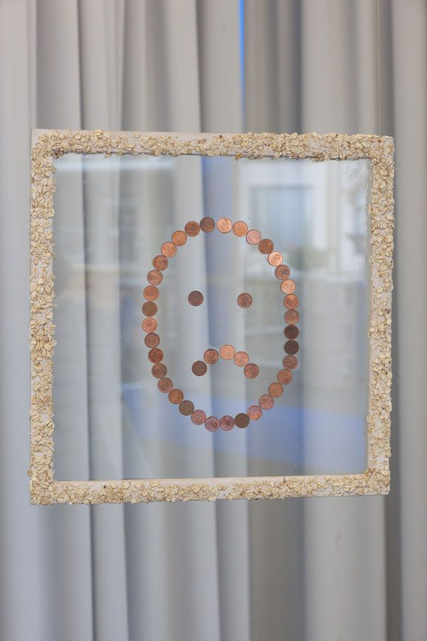 UNHAPPY OATS, oatmeal on wood, glass and cent pieces, 2013