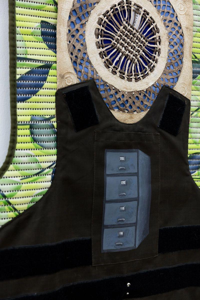 Ana Navas, United(Detail),2018, mat, plaster, fabric, paper, metal, bulletproof vest, piercing,193 × 65 cm, photo: Sebastian Kissel