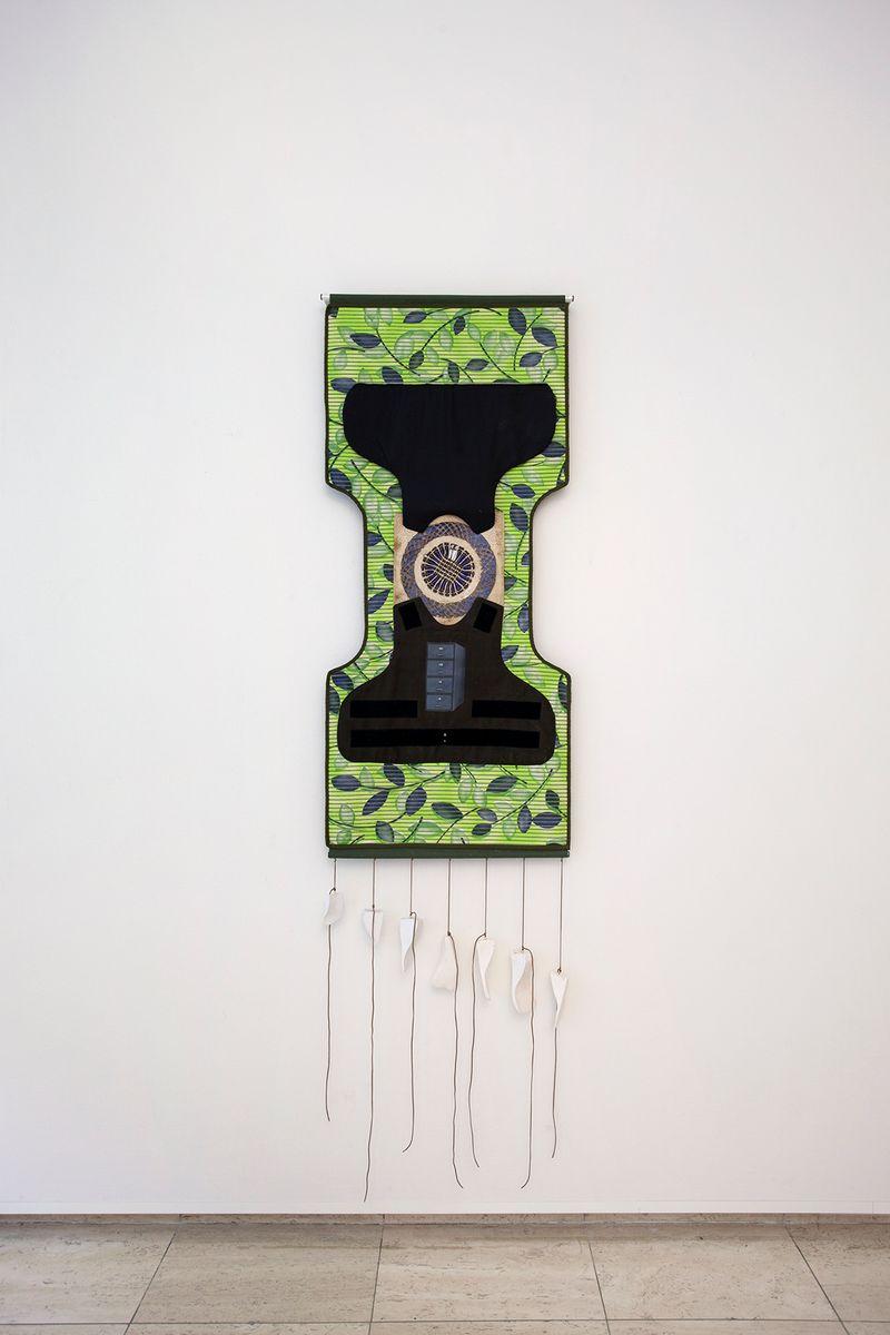 Ana Navas, United,2018, mat, plaster, fabric, paper, metal, bulletproof vest, piercing,193 × 65 cm, photo: Otto Polman