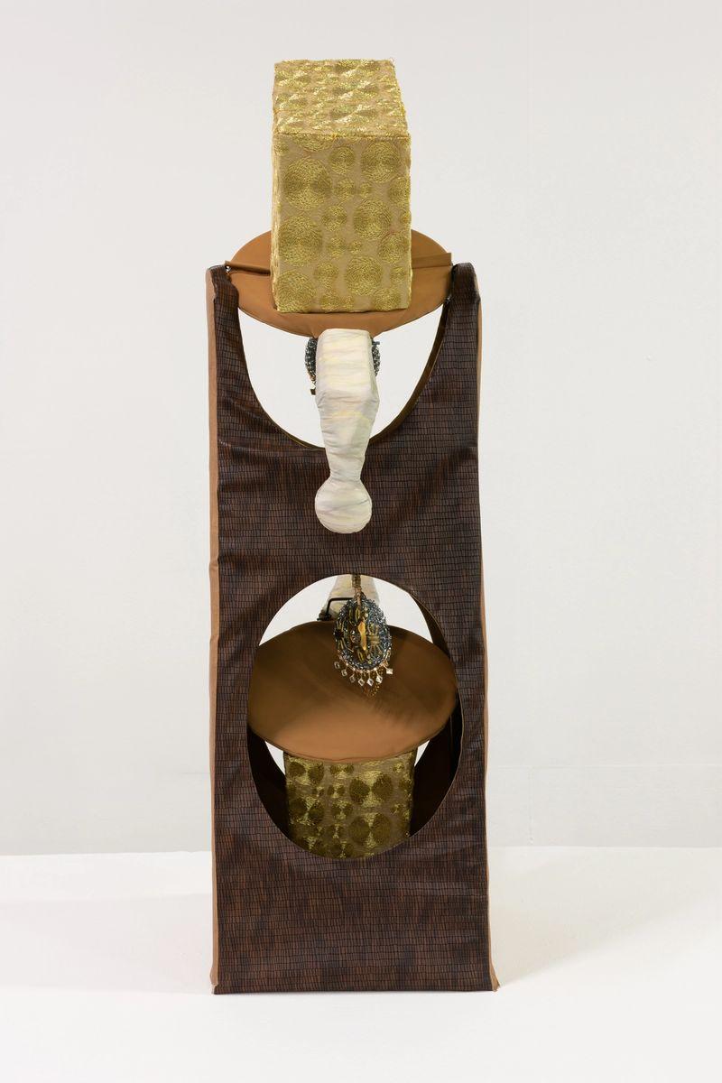 Ana Navas, Buddhasen Nanas, 2019,water bottle rack, fabric, bijouterie, cardboard, acrylic,115 × 35 × 40 cm, photo: Diego Torres
