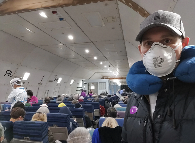 Selfie from inside a plane transporting COVID patients