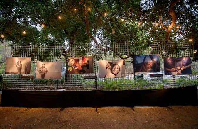 Photos of people affected by incarceration posted on a fence.