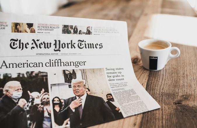 "Newspaper with headline ""American Cliffhanger"""