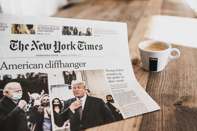"Newspaper with headline ""American Cliffhanger"""
