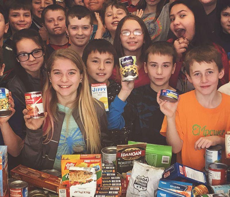 volunteering kids holding donations