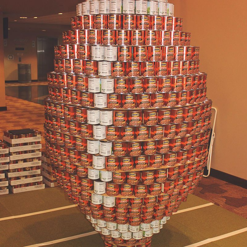 food donations arranged into a football