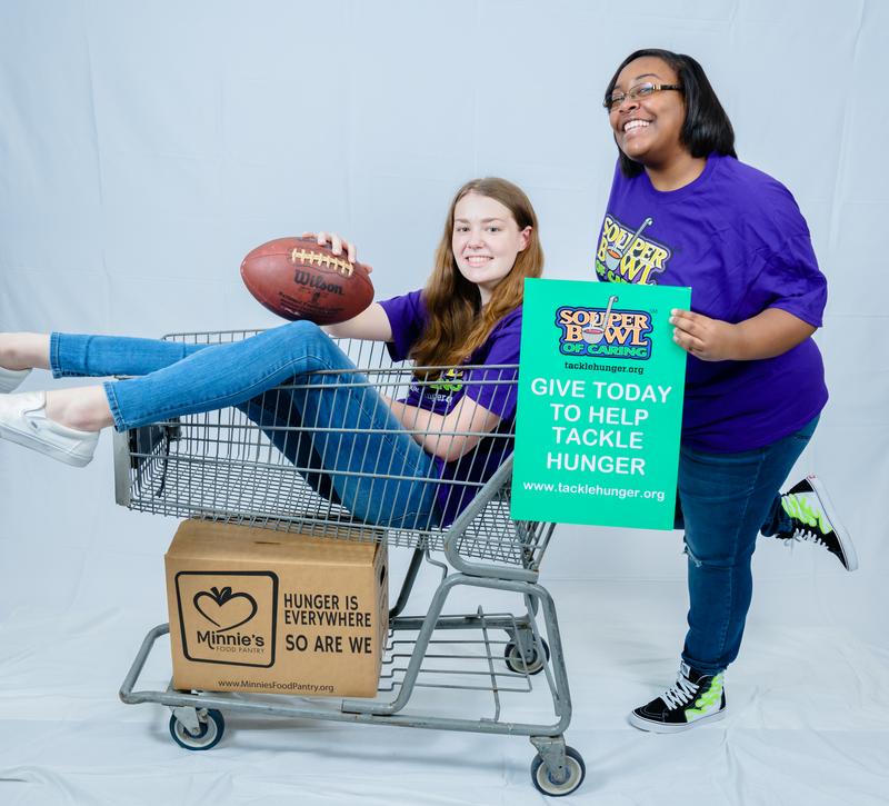 volunteers in grocery cart