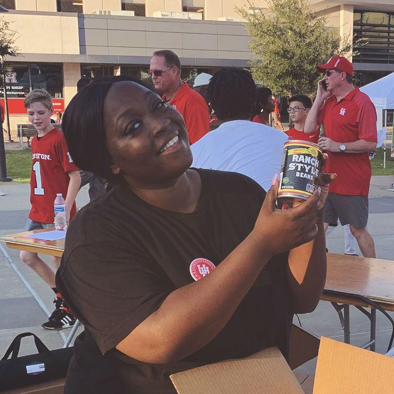 female volunteer showing donated food