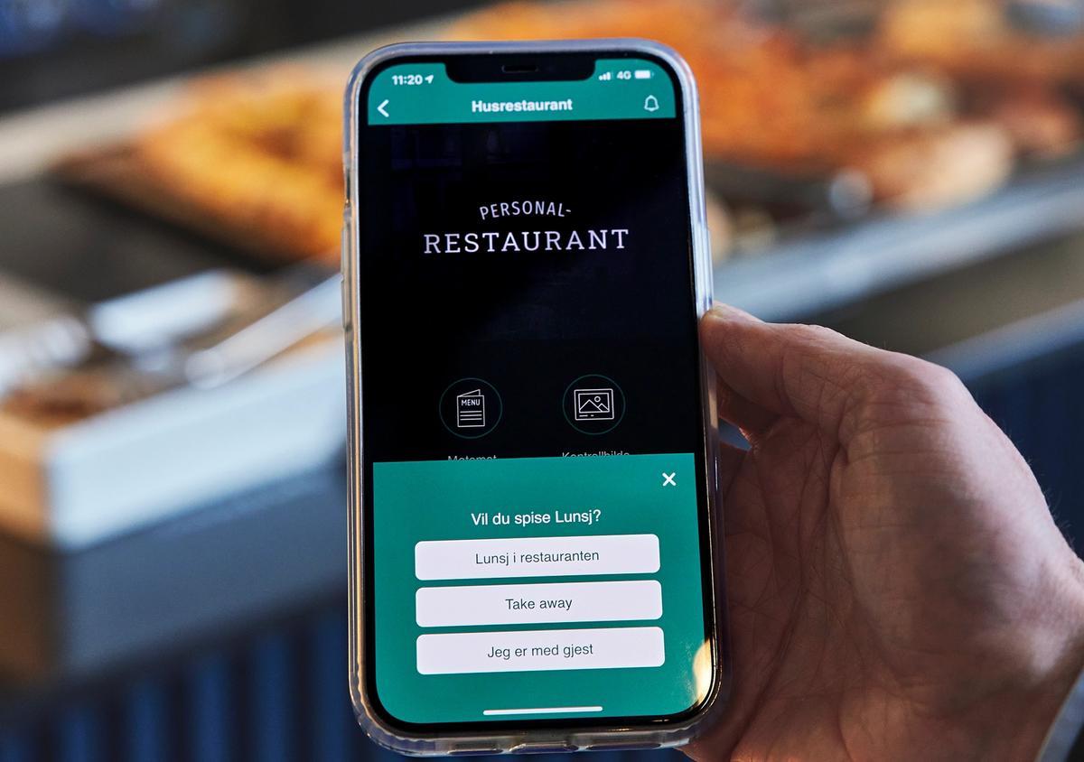 En iphone som viser appen til 4Service
