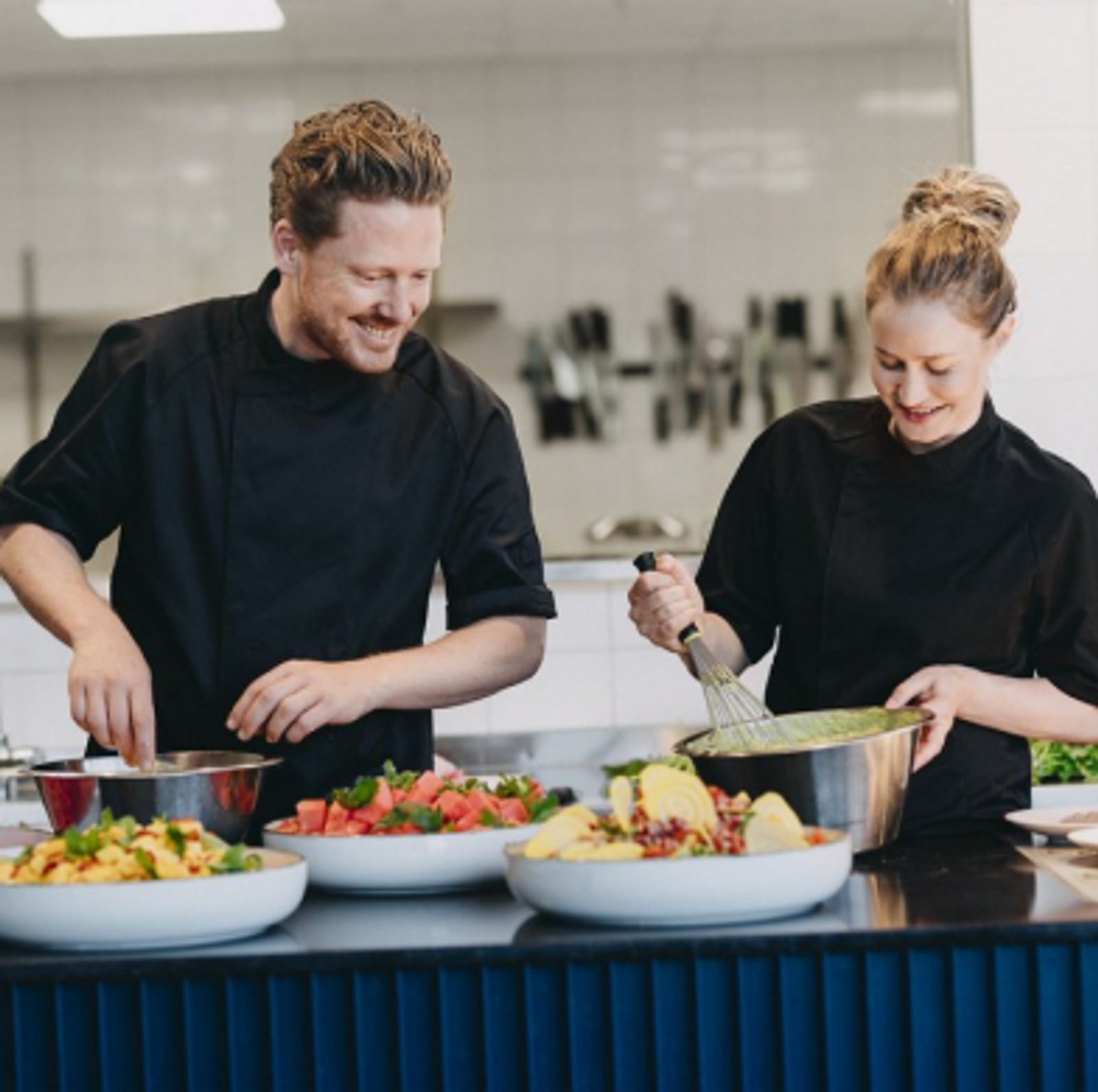 two people in a kitchen cooking together