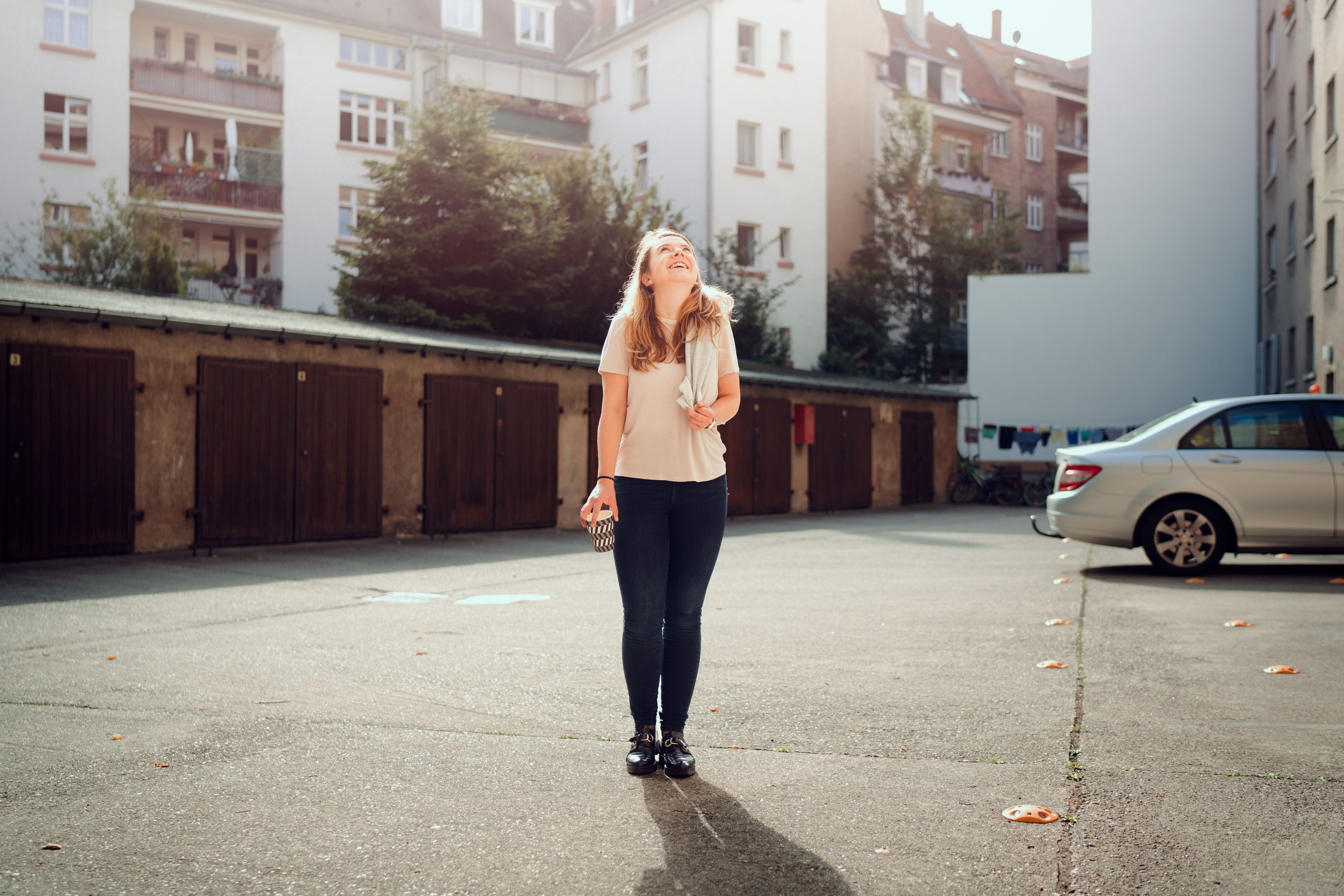 Marie in front of garage