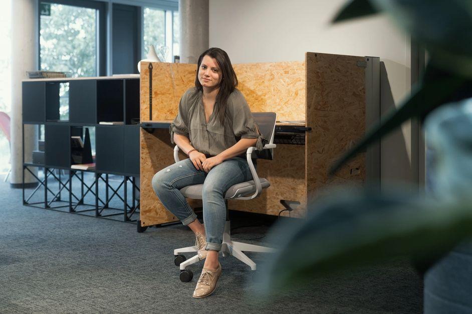 Debora in the office sitting