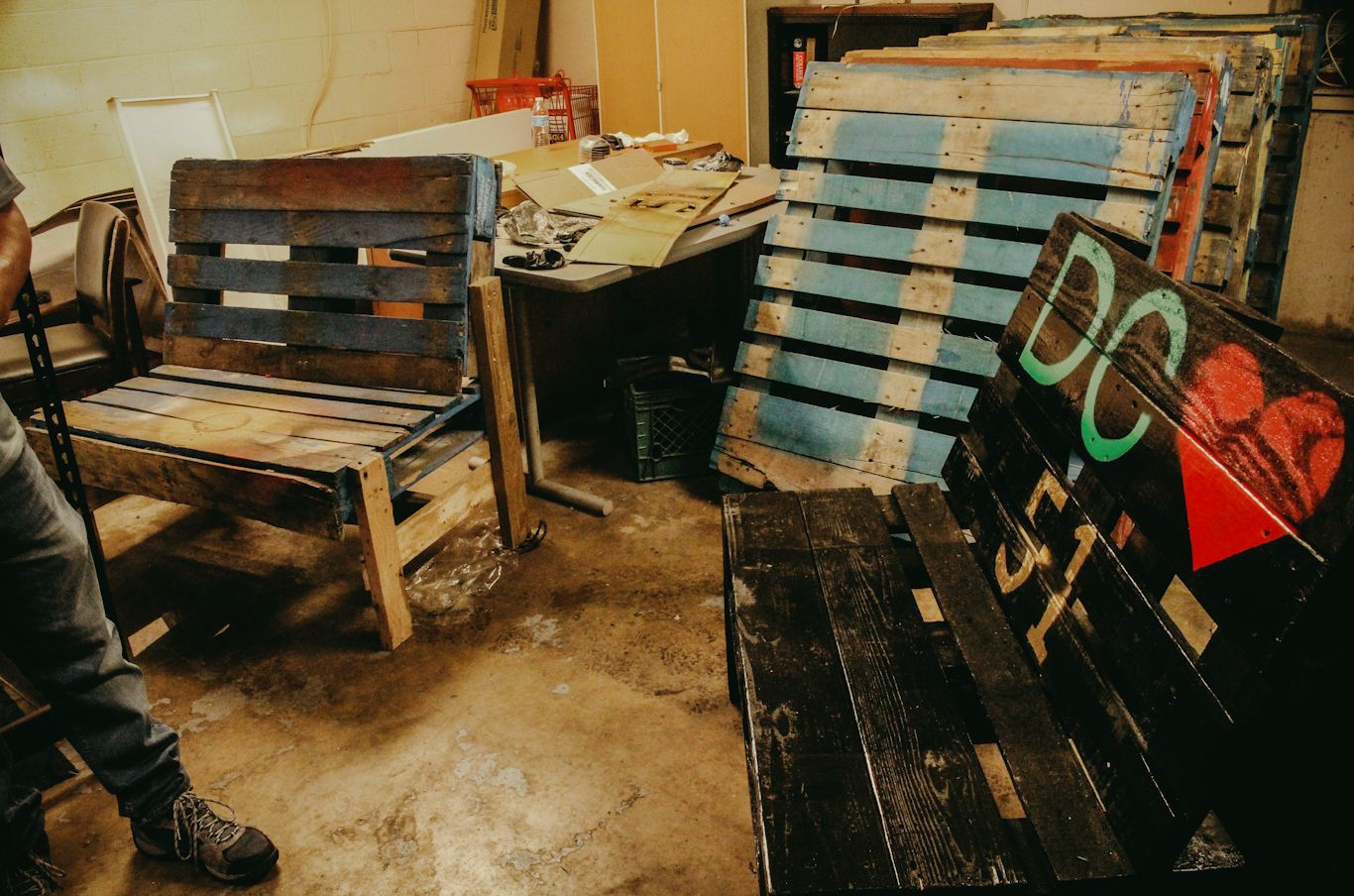 Boe's workshop where he turns discarded pallets into benches with a message.