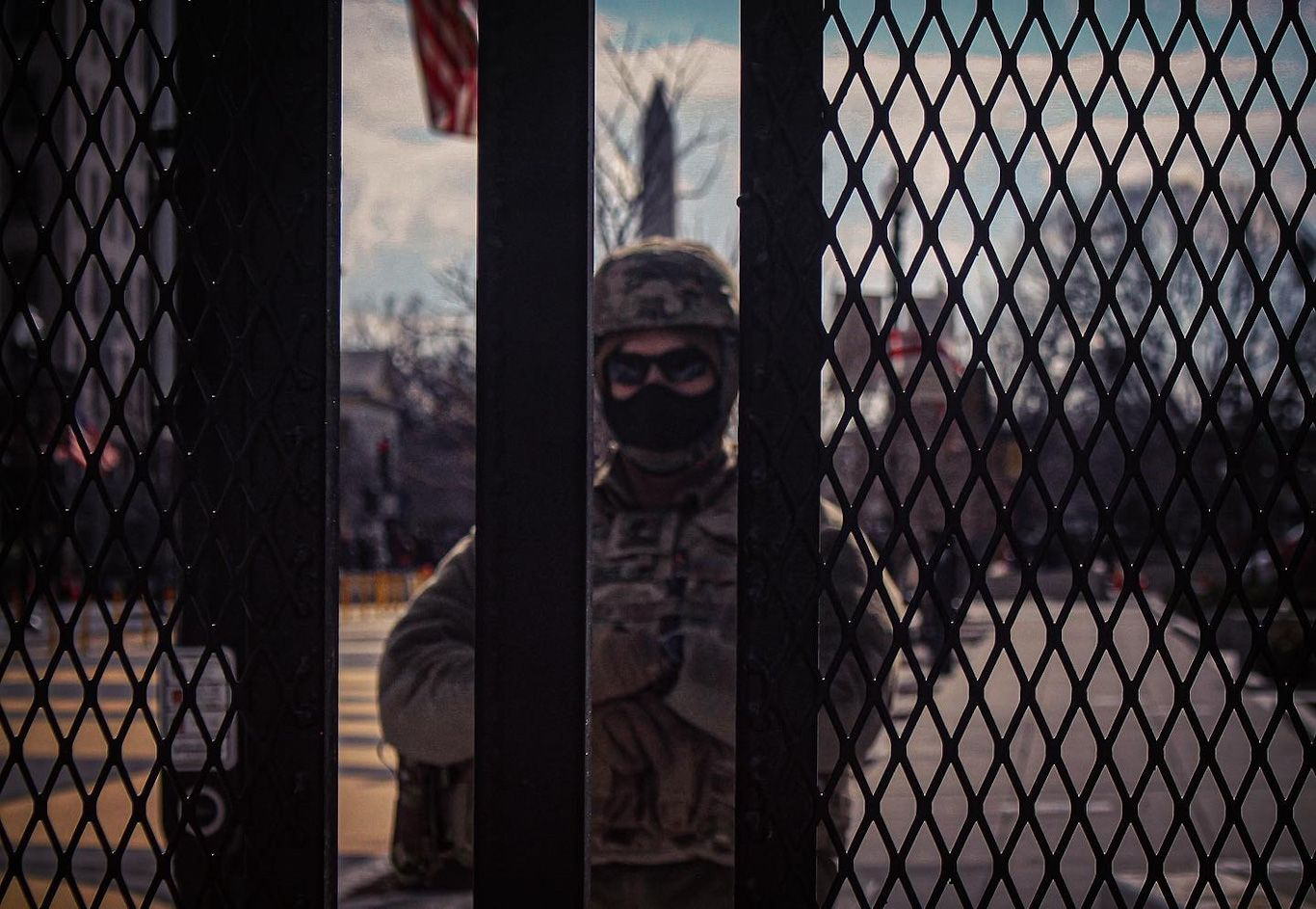 military police stan behind metal gates on inauguration day
