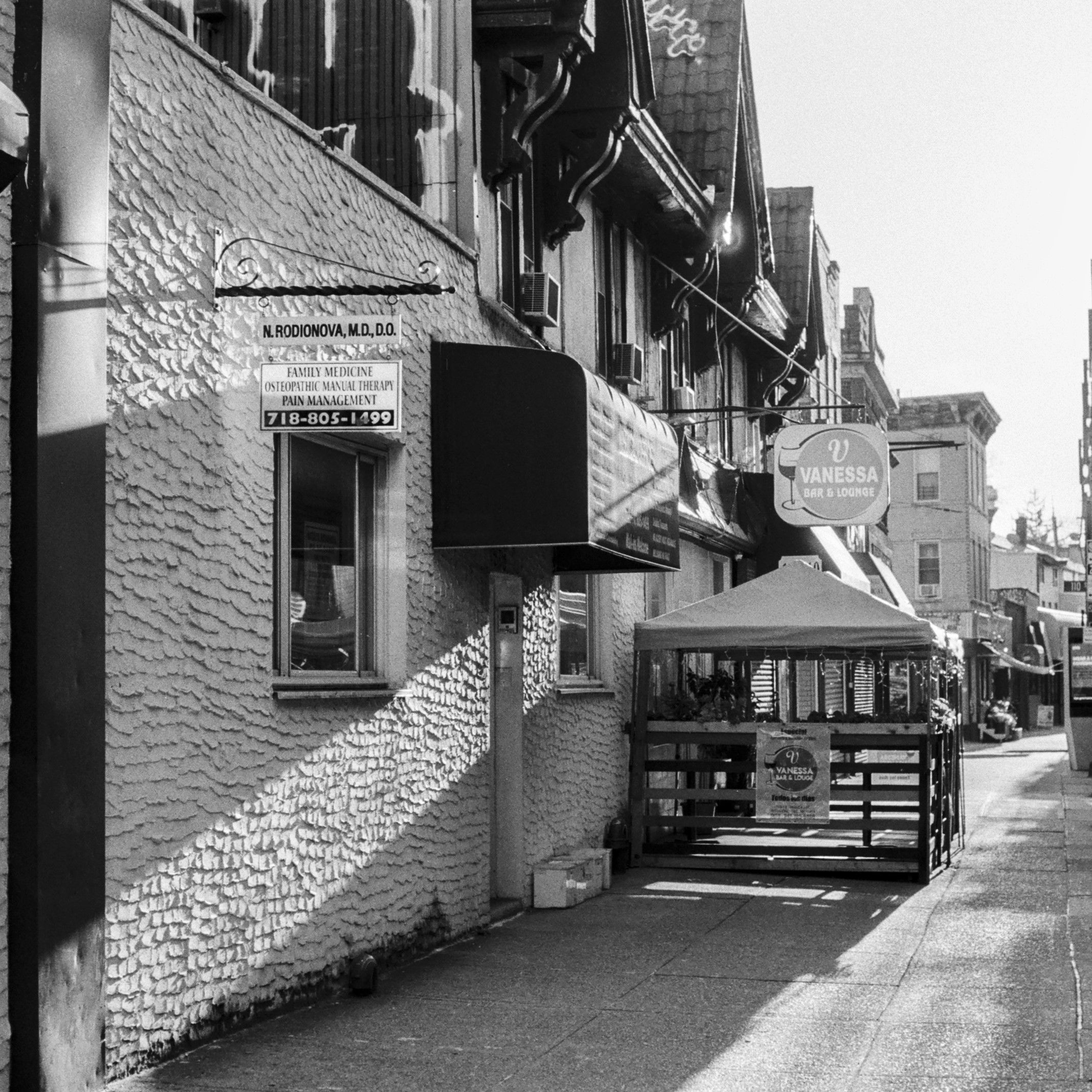 black and white image of a street in Queens