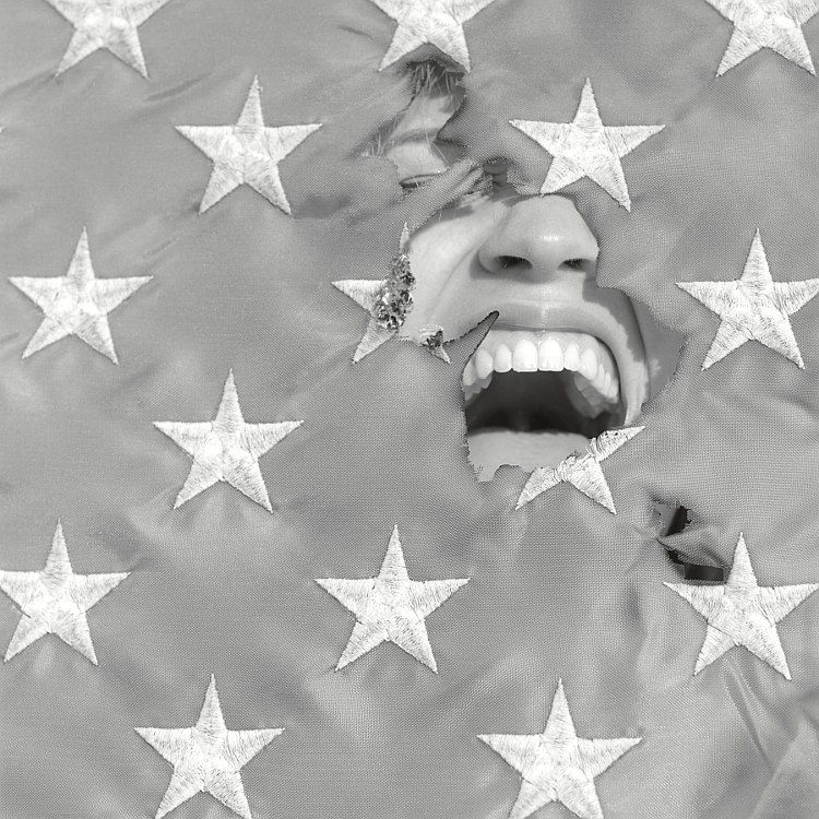 screaming through a torn flag
