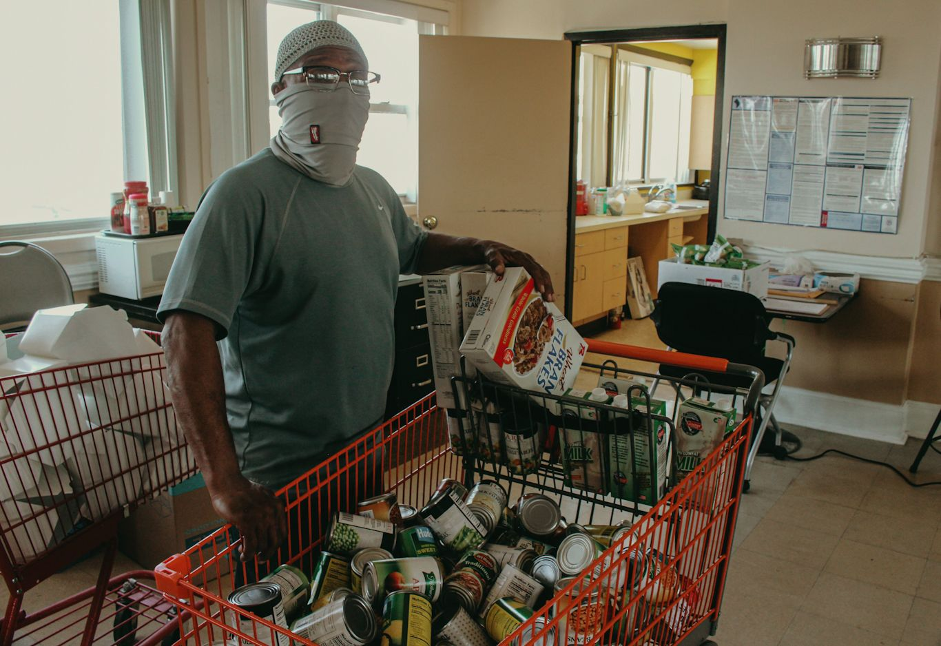 Boe in the community room with some of the foodstuffs available to residents.