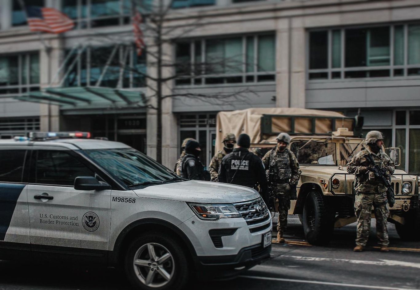 CBP and military police stand at an intersection close to inauguration green zone