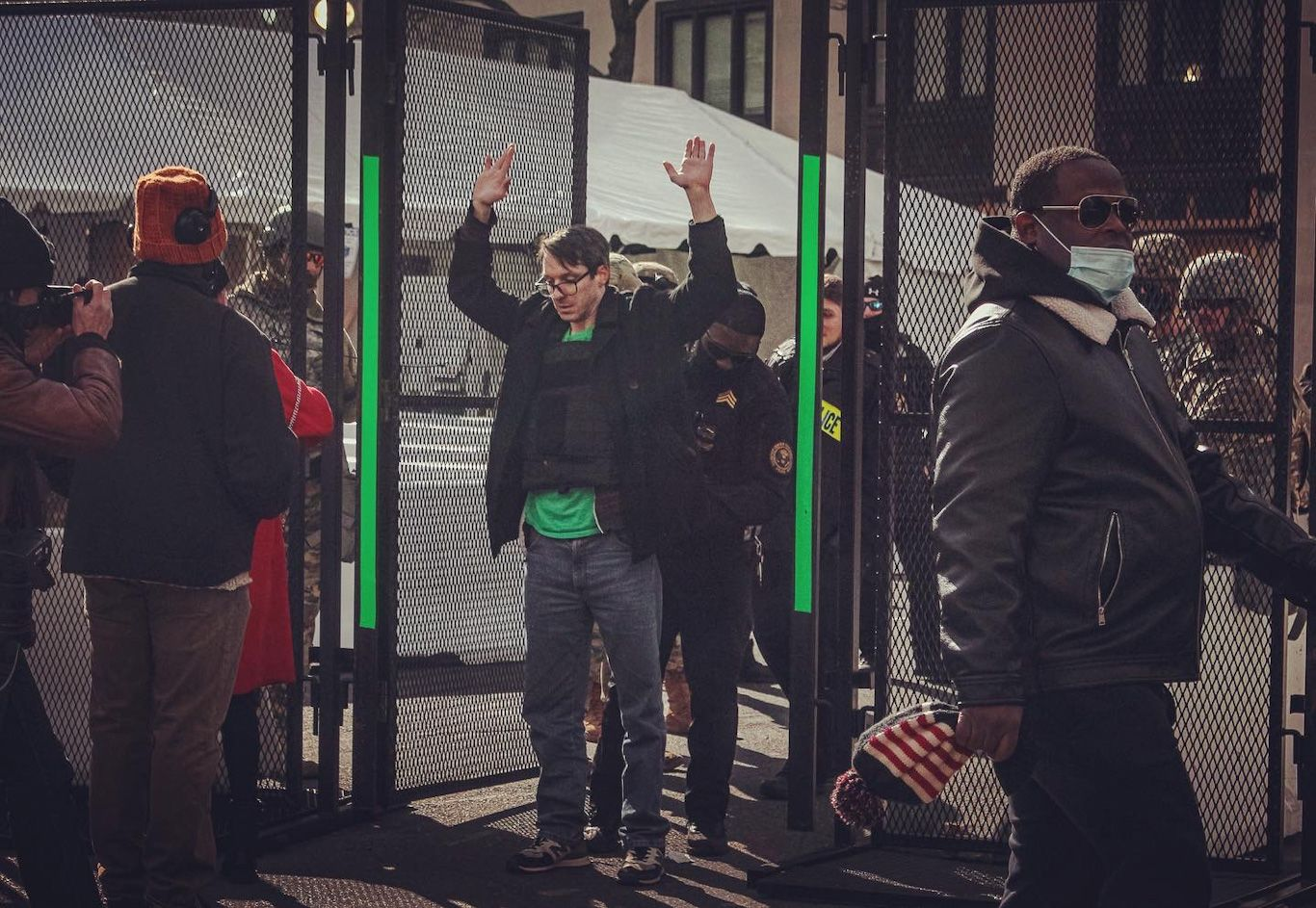 man with bullet proof vest on standing to be wanded at entrance to inauguration green zone