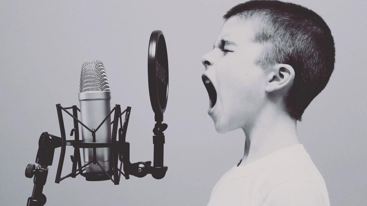 Child screaming in a microphone