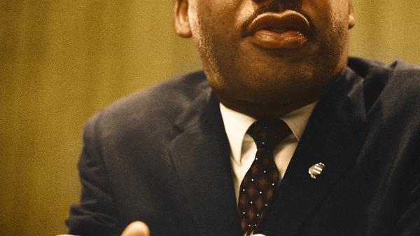 Bilde av Martin Luther King jr. tatt av Unseen Histories fra Unsplash