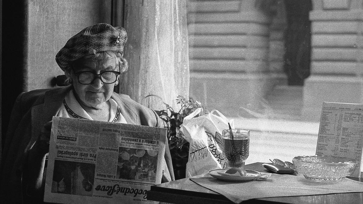 Older lady reading a newspaper